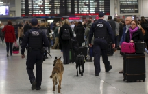 Amtrak Police K-9 teams patrol a busy Pennsylvania Station in the Manhattan borough of New York City, November 25, 2015.