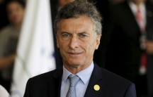 Argentina's President Mauricio Macri arrives for a session of the Summit of Heads of State of MERCOSUR and Associated States and 49th Meeting of the Common Market Council in Luque, Paraguay, December 21, 2015.