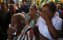 Residents react during the funeral of newly-installed Temixco mayor Gisela Mota in Temixco, south of Mexico City, after Mota was shot dead on Saturday by four armed gunmen, January 3, 2016.
