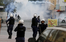 Riot police fires tear gas at protesters during clashes after a protest against the execution of prominent Shi'ite Muslim cleric Nimr al-Nimr by Saudi authorities in village of Sitra south of Manama, Bahrain, January 5, 2016.