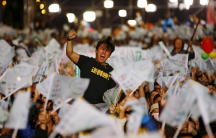 A supporter of Democratic Progressive Party (DPP) Chairperson and presidential candidate Tsai Ing-wen celebrates to preliminary results at their party headquarters in Taipei, Taiwan
