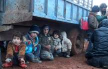 Displaced Syrian children waiting to cross the border into Turkey