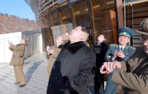 North Korean leader Kim Jong Un watches the rocket launch in an official North Korean government photo.