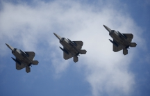 US F-22 stealth fighter jets fly over Osan Air Base in Pyeongtaek, South Korea, Feb. 17, 2016.