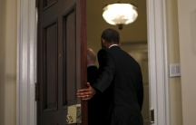 President Barack Obama and Vice President Joe Biden leave the Roosevelt room after delivering a statement on Guantanamo at the White House in Washington February 23, 2016.