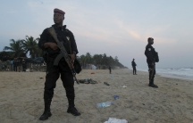 Soldiers stand guard after the beach attack at Grand Bassam in Ivory Coast