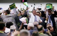 Congressional committee members celebrate after voting to go ahead with impeachment proceedings against Brazilian President Dilma Rousseff at the National Congress in Brasilia on April 11.