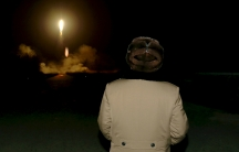 North Korean leader Kim Jong-un watches the ballistic missile test at an unknown location, in this undated file photo released by North Korea's Korean Central News Agency in Pyongyang on March 11, 2016.