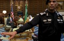 A guard ushers away photographers as President Barack Obama meets with Saudi King Salman in Riyadh, Saudi Arabia April 20, 2016