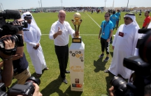 FIFA's newly elected president Gianni Infantino poses with the Qatar Workers Cup trophy in Doha, Qatar, April 22, 2016.