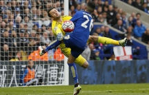 Leicester City's Riyad Mahrez crashes into Swansea's Lukasz Fabianski on the pitch.