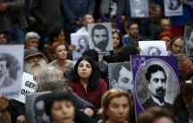 Activists hold portraits of victims during a silent demonstration on April 24 to commemorate the mass killings of Armenians by Ottoman Turks in Istanbul, Turkey.