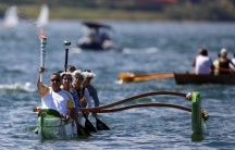 Canoeist Rubens Pompeu takes part in the Olympic torch relay at Paranoa lake in Brasilia, Brazil on May 3.