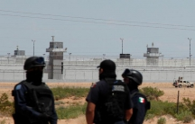 "​Federal police officers stand guard near a prison in Ciudad Juarez, where Mexican drug boss Joaquin ""Chapo"" Guzman was moved from his jail, in central Mexico, May 7, 2016."