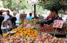 An Egyptian women shops at a vegetable market in Cairo, Egypt