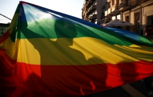 Participants are silhouetted while holding a rainbow flag during the annual gay pride parade in central Nicosia, Cyprus May 29, 2016.