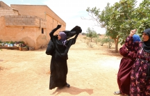 Souad Hamidi, 19, removes the niqab she said she had been forced to wear since 2014, after U.S.-backed Syria Democratic Forces took control of her village in northern Syria from Islamic State fighters on June 9, 2016.