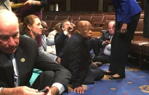 """A photo shot and tweeted from the floor of the House by U.S. House Rep. John Yarmuth shows Democratic members of the U.S. House of Representatives, including Rep. Joe Courtney (L) and Rep. John Lewis (C) staging a sit-in on the House floor """"to demand acti"""