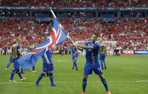 Iceland's Kari Arnason celebrates after the victorious match.