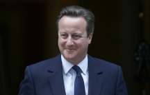 Britain's Prime Minister, David Cameron, putting on a brave face as he heads for the House of Commons, in London, Monday