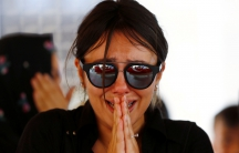 A friend of Gulsen Bahadir, a victim of Tuesday's attack on Ataturk airport, mourns during her funeral ceremony in Istanbul, Turkey, June 29, 2016.