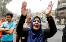 A woman reacts at the site of Sunday's suicide bomb attack in Baghdad. Residents are angry with the government's failure to deliver promised security.