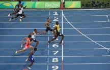 2016 Rio Olympics - Athletics - Final - Men's 100m Semifinal - Olympic Stadium - Rio de Janeiro, Brazil - 14/08/2016. Usain Bolt (JAM) of Jamaica crosses the finish line.