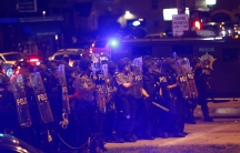 Police advance toward protesters during disturbances following the police shooting of a man in Milwaukee, Wisconsin, U.S. August 14, 2016. REUTERS/Aaron P. Bernstein