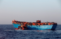 A rescue boat of the Spanish NGO Proactiva approaches an overcrowded wooden vessel with migrants from Eritrea, off the Libyan coast in Mediterranean Sea August 29, 2016. REUTERS/Giorgos Moutafis