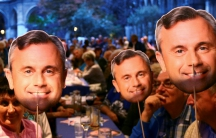 Supporters of Austrian far right Freedom Party (FPOe) presidential candidate Norbert Hofer hold images of his face in Vienna, Austria.