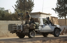 US soldiers ride a military vehicle in al-Kherbeh village, northern Aleppo province, Syria on Oct. 24.