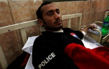 A police cadet injured during the attack on the Police Training Center lies in bed in a hospital in Quetta, Pakistan.