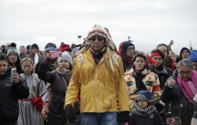 Chief Arvol Looking Horse, spiritual leader of the Sioux Nation, leads his people to peacefully pray near a law enforcement barricade just outside of a Dakota Access pipeline construction site north of Cannon Ball, North Dakota, on Oct. 29, 2016.