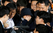 Choi Soon-sil (C), who is involved in a political scandal, reacts as she is surrounded by media upon her arrival at a prosecutor's office in Seoul, South Korea, October 31, 2016.