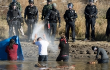 Police use pepper spray against protesters trying to cross a stream near an oil pipeline construction site near Standing Rock Indian Reservation, north of Cannon Ball, North Dakota, U.S. November 2, 2016.