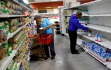 People look for groceries and goods at a supermarket in Caracas, Venezuela November 11, 2016.