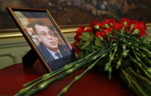 Flowers are placed near a portrait of murdered Russian ambassador to Turkey Andrei Karlov