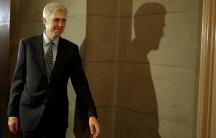 A man walks around the halls of capitol hill
