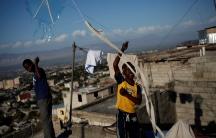 Children fly kites in a neighborhood of Port-au-Prince, Haiti, February 8, 2017.
