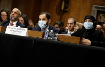Drs. Abdulkhalek (center) and Farida (right)  look on during a Senate Foreign Relations hearing on the conflict in Syria on Capitol Hill in Washington.