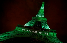 The Eiffel Tower lit up in green