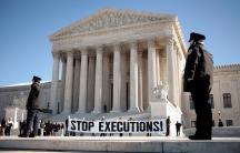 A panel protesting the death penalty is unfurled at the supreme court