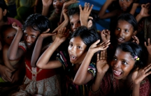 Rohingya refugee children attend a makeshift school at Balukhali Makeshift Refugee Camp in Cox's Bazar, Bangladesh.