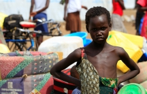 A South Sudanese refugee girl, displaced by fighting, arrives at Imvepi settlement in Arua district, northern Uganda, April 4, 2017.
