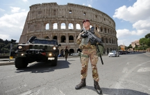 a soldier in front of the colloseum