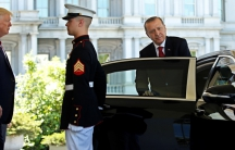 President Donald Trump watches as Turkey's President Recep Tayyip Erdogan departs at the entrance to the West Wing of the White House in Washington on May 16.