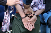 A man is handcuffed.