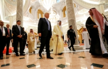 President Donald Trump walks with Saudi Arabia's King Salman bin Abdulaziz Al Saud