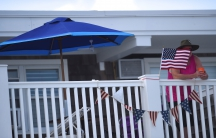 A U.S. flag and patriotic bunting is displayed on a beachside motel in New Jersey.