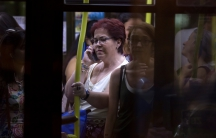 A woman talks on her cellphone on a bus in Madrid.